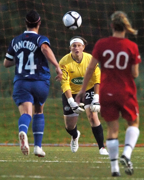 Colorado Force goalie Lauren Robertson stops a shot by Vancouver Whitecaps forward Melissa Tancredi while Corie Moore looks on in the first half of their game on Sunday, June 6, 2010 at the Loveland Sports Park.