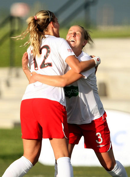 Colorado Force's Lisa Kosena (12) and Julie Rezac (3) celebrate Kosena's first half goal against the Pali Blues on Thursday, June 10 at the Loveland Sports Park.