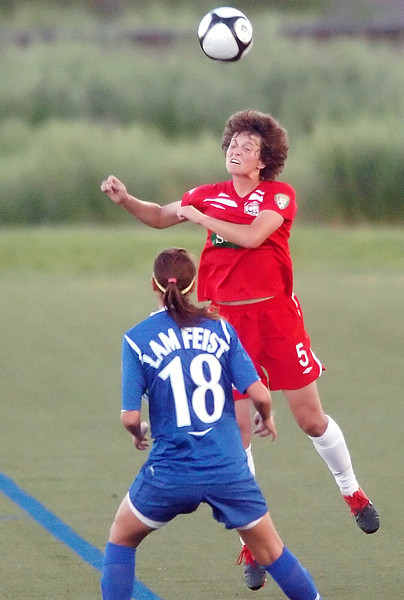 Colorado Force defender Sarah Gress goes up for a header in front of  Monica Lam-Feist of the Vancouver Whitecaps in the first half of their game on Sunday, June 6, 2010 at the Loveland Sports Park.
