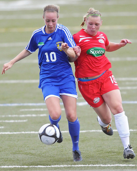 Colorado Force forward Lisa Franke, right, and Seattle Sounders defender Jamie Coe track down the ball in the first half of their game on Friday, June 4, 2010 at the Loveland Sports Park.