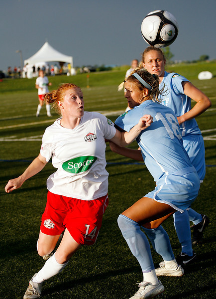 Colorado Force's Christie Ehrhardt (14) keeps an eye on the ball as her slips past Pali Blues' Christie Shaner (18) during the first half of their game Thursday, June 10 at the Loveland Sports Park.