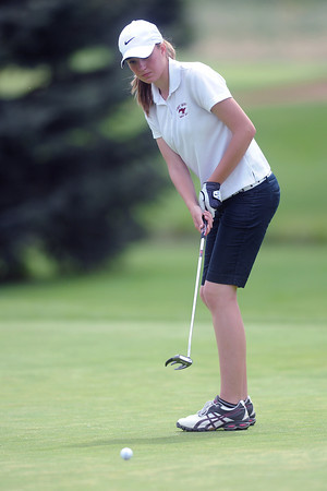 Fort Morgan High School sophomore Kaitlyn Mobley watches her putt on No. 4 during the R2-J Tournament on Wednesday, April 25, 2012 at Mariana Butte Golf Course in Loveland, Colo.