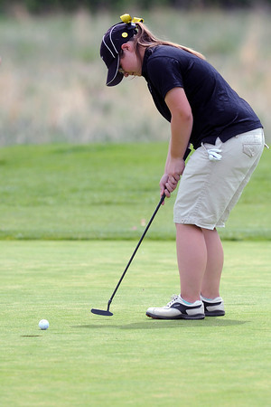 Thompson Valley High School senior Regan Musilek hits a putt on No. 3 during the R2-J Tournament on Wednesday, April 25, 2012 at Mariana Butte Golf Course.