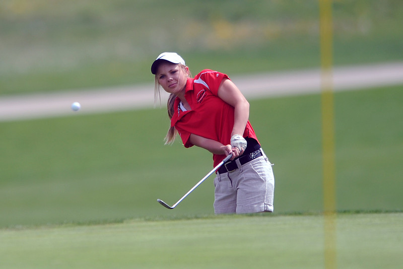 Loveland High School's Kelsey Peterson chips onto the No. 13 green during the R2-J Tournament on Wednesday, April 25, 2012 at Mariana Butte Golf Course.