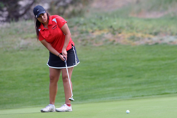 Loveland High School's Raquell Castillo watches her putt on No. 10 during the R2-J Tournament on Wednesday, April 25, 2012 at Mariana Butte Golf Course.