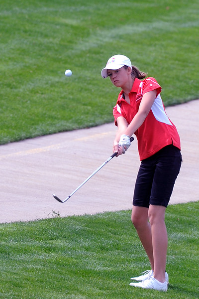 Loveland High School's Aubrey Doran hits a chip shot on No. 10 during the R2-J Tournament on Wednesday, April 25, 2012 at Mariana Butte Golf Course.