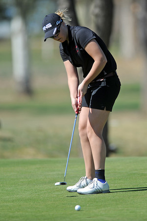 Berthoud High School's Brandi Peter watches her putt on hole No. 7 during a Northern Conference meet Wednesday, April 4, 2012 at The Olde Course.