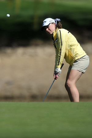 Thompson Valley High School's Lauren Mickelson chips onto the green at No. 7 during a Northern Conference meet Wednesday, April 4, 2012 at The Olde Course.