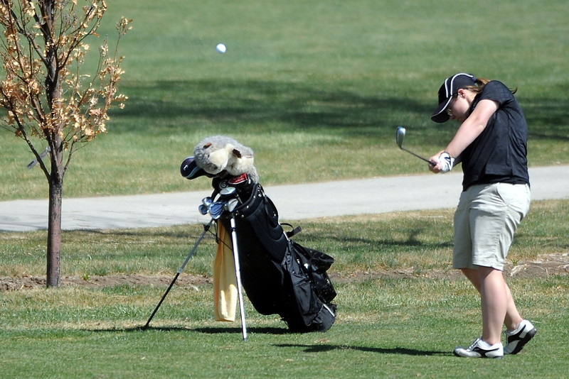 Thompson Valley High School's Regan Musilek hits an approach shot on hole No. 5 during a Northern Conference meet Wednesday, April 4, 2012 at The Olde Course.