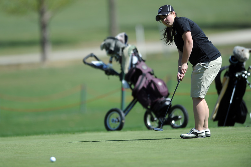 Thompson Valley High School's Regan Musilek watches her putt on hole No. 5 during a Northern Conference meet Wednesday, April 4, 2012 at The Olde Course.