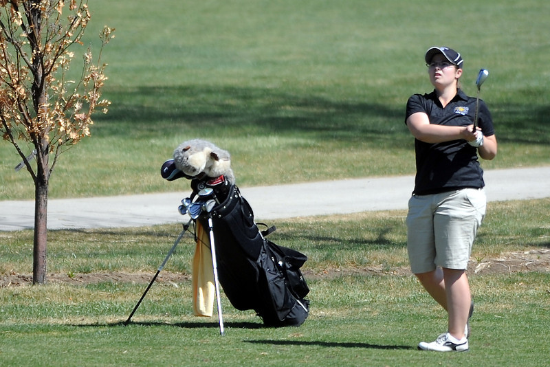 Thompson Valley High School's Regan Musilek watches her approach shot on hole No. 5 during a Northern Conference meet Wednesday, April 4, 2012 at The Olde Course.