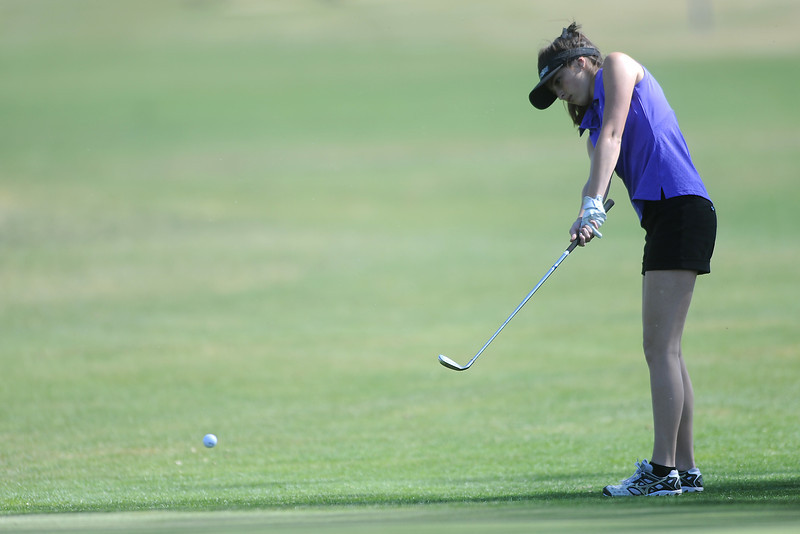 Mountain View High School's Madison Polansky hits a chip shot on hole No. 7 during a Northern Conference meet Wednesday, April 4, 2012 at The Olde Course.