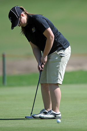 Thompson Valley High School's Regan Musilek hits a putt on hole No. 5 during a Northern Conference meet Wednesday, April 4, 2012 at The Olde Course.