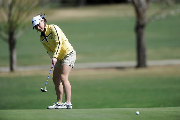 Thompson Valley High School's Lauren Mickelson watches her putt on hole No. 5 during a Northern Conference meet Wednesday, April 4, 2012 at The Olde Course.