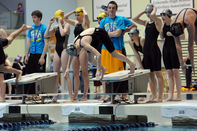 Mountain View High School's 200-yard freestyle team at the start of the consolation finals of the Class 4A State Championships on Saturday, Feb. 11, 2012 at Veterans Memorial Aquatics Center in Thornton.