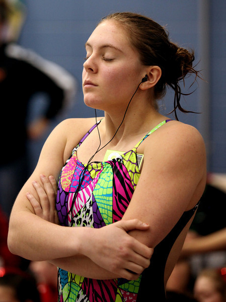 Loveland junior diver Michal Bower works on her focus prior to the start of Saturday's diving finals during the 5A State Championship Meet at EPIC in Fort Collins.