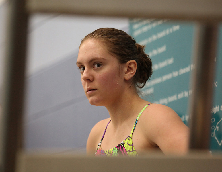 Loveland junior diver Michal Bower watches the competition and waits for her final dive Saturday during the 5A State Championship Meet at EPIC in Fort Collins.
