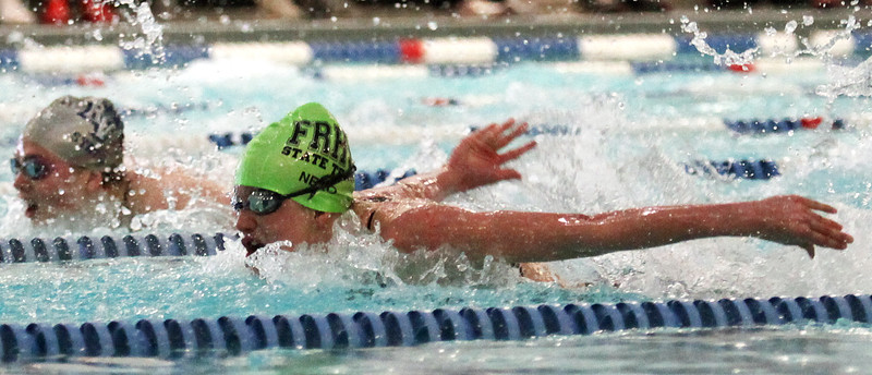 Fossil Ridge freshman Bailey Nero battles Ralston Valley sophomore Erin Metzger-Seymour in the 100-yard butterfly final Saturday at EPIC in Fort Collins. Nero won the race in 54.74, less than half a second from a state record.