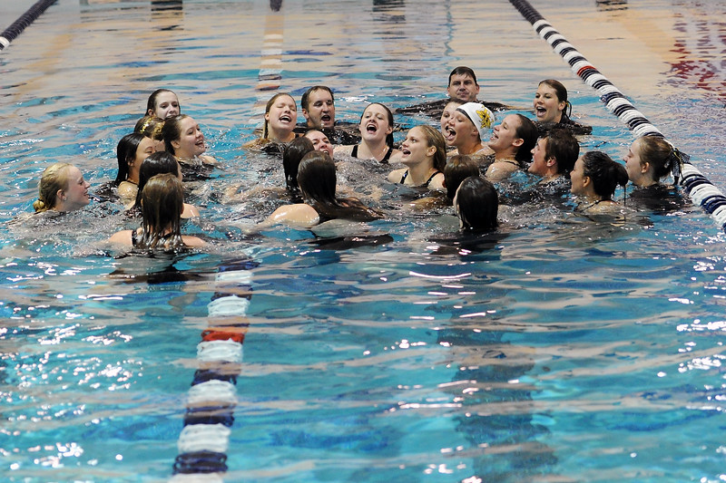 Thompson Valley High School's swim and dive team celebrates together in the pool after winning the team title at the conclusion of the Class 4A State Championships on Saturday, Feb. 11, 2012 at Veterans Memorial Aquatics Center in Thornton.