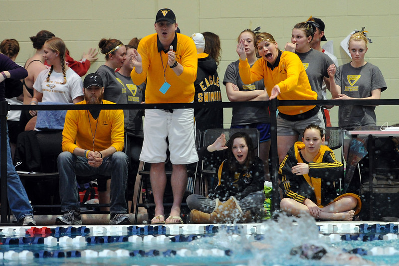 Thompson Valley High School swim team members and coaches yell encouragement during the 500-yard freestyle consolation finals of the Class 4A State Championships on Saturday, Feb. 11, 2012 at Veterans Memorial Aquatics Center in Thornton.