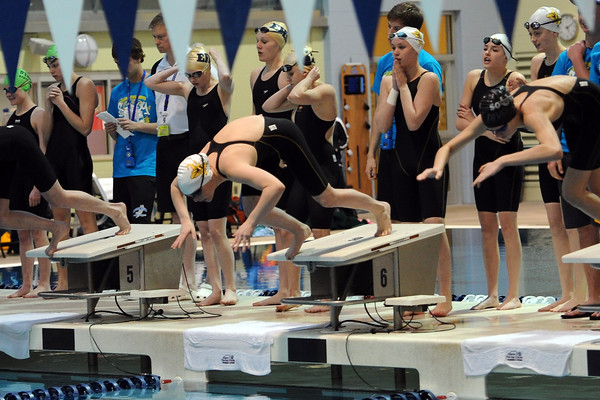 Thompson Valley High School's 400-yard freestyle relay team at the start of the finals during the Class 4A State Championships on Saturday, Feb. 11, 2012 at Veterans Memorial Aquatics Center in Thornton.