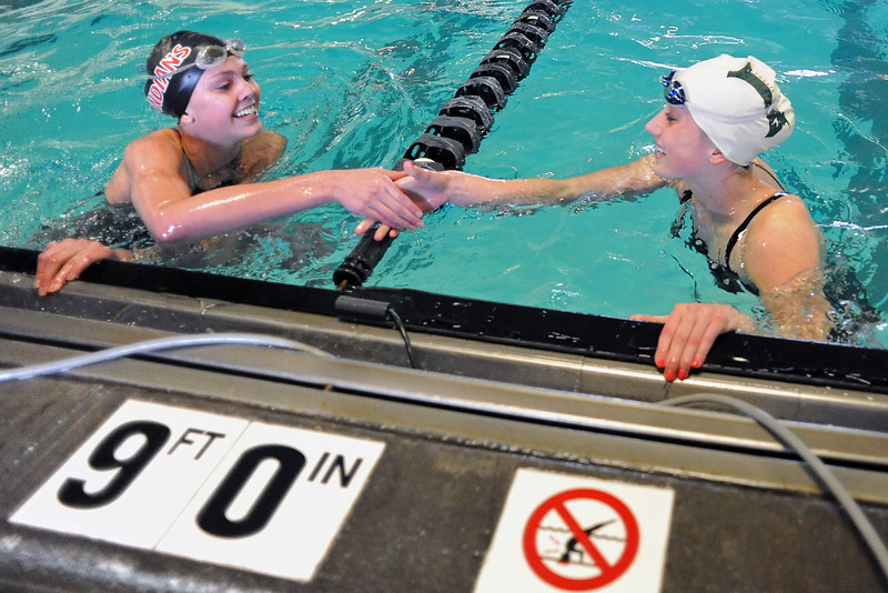 Fossil Ridge High School junior Rhianna Williams, right, and Loveland freshman Brooke Hansen congratulate one another after finishing in first and second place respectively in the 50-yard freestyle during the Front Range Class 5A Championship on Saturday, Feb. 4, 2012 at the Mountian View Aquatic Center.