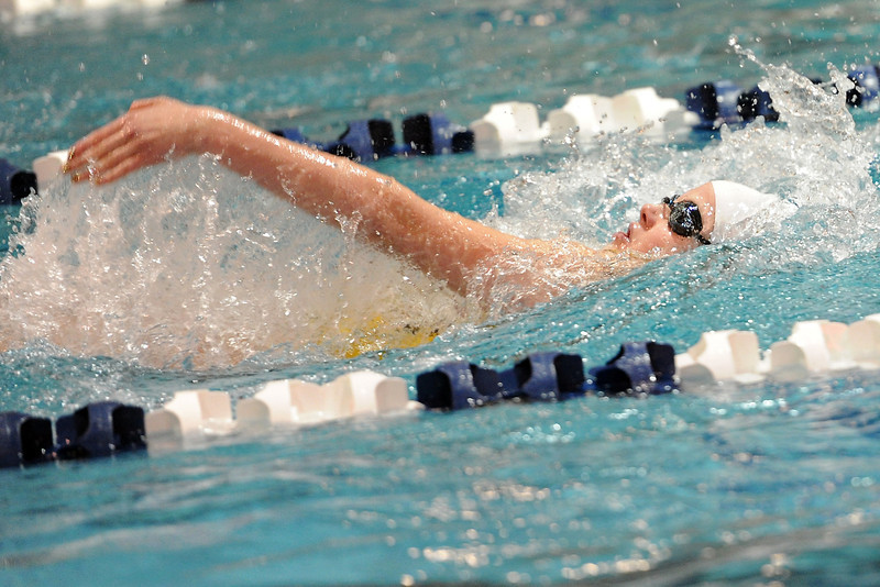 Thompson Valley High School junior Jessi Modlich swims in a preliminary heat of the 100-yard backstroke during the Class 4A State Swimming Championships on Friday, Feb. 10, 2012 at Veterans Memorial Aquatics Center in Thornton.