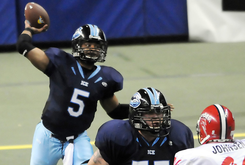 Colorado Ice quarterback David Knighton throws a pass while teammate John Godsil blocks Sioux Falls Storm defender Cory Johnsen in the third quarter of their game on Saturday, June 5, 2010 at the Budweiser Events Center.