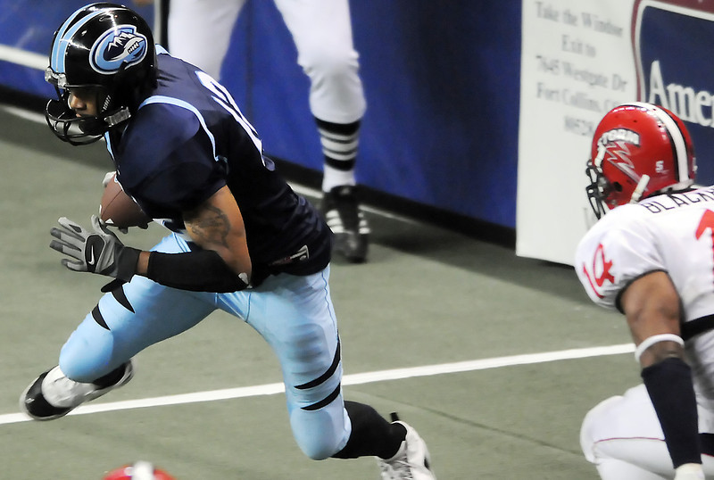 Colorado Ice wide receiver Sherard Ellis is pursued after a catch by Mark Blackburn of the Sioux Falls Storm in the third quarter of their game Saturday, June 5, 2010 at the Budweiser Events Center.