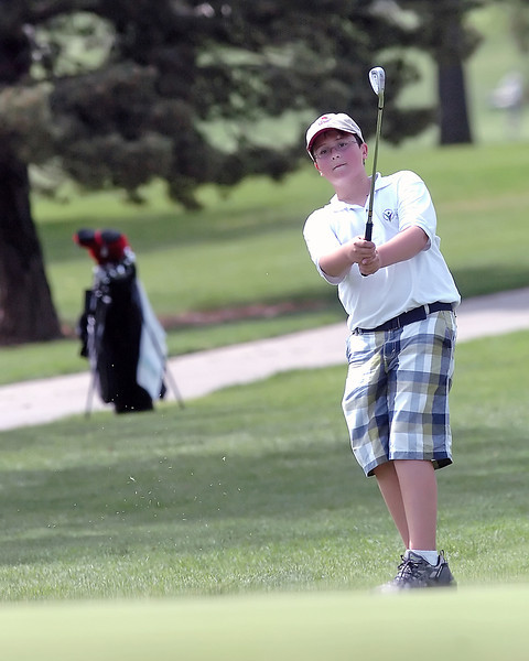 Austin Branscum, 12, watches his chip shot on hole number 6 while playing in the Loveland Breakfast Optimists Junior Golf Tournament on Monday, June 7, 2010 at The Olde Course at Loveland.
