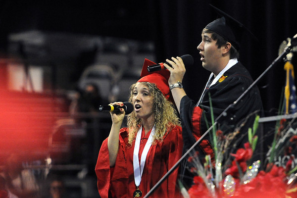 """Loveland High School's Mariah Van Tress, left, and Brady Hilgenberg sing the song """"The Prayer"""" during the school's graduation ceremony on Saturday, May 25, 2013 at the Budweiser Events Center."""