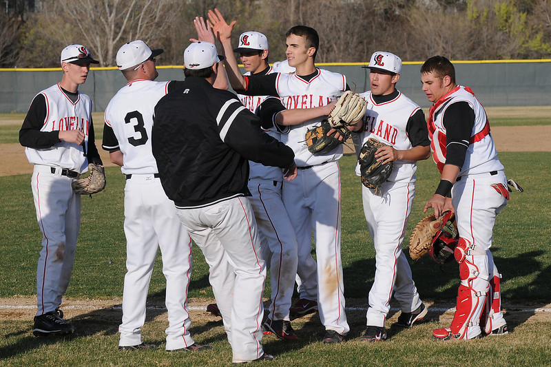 Loveland High School baseball players congratulate each other after defeating Fossil Ridge on Friday afternoon at Swift Field. The Indians won, 10-8.