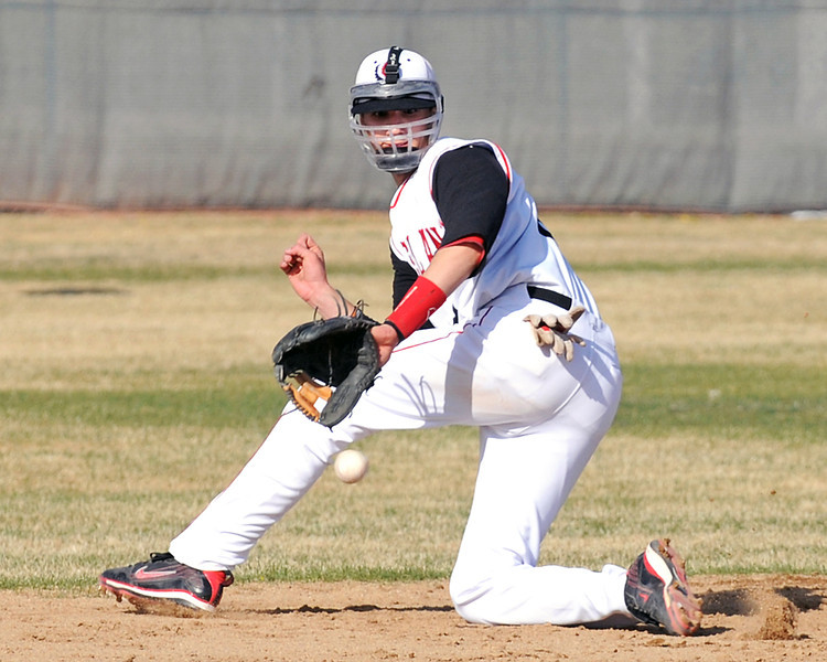 Loveland High School shortstop Darius Coldiron fields a ground ball during a game against Fossil Ridge on Friday, April 15, 2011 at Swift Field.