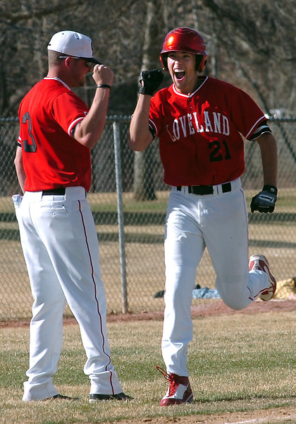 Loveland's #21 is all smiles as he rounds the bases after a home run.