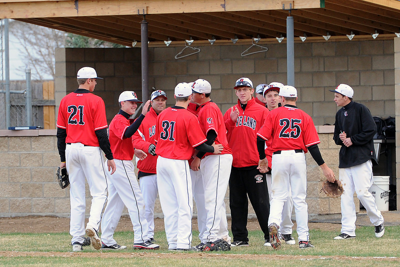Loveland High School baseball players congratulate each other after defeating Thompson Valley on Tuesday, April 3, 2012 at Constantz Field, 6-4.
