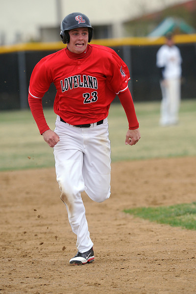 Loveland High School baserunner Ryan McCloughan advances to third base on an overthrow in the top of the fourth inning of a game against Thompson Valley on Tuesday, April 3, 2012 at Constantz Field.