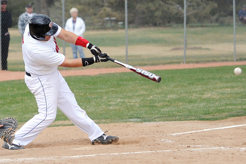 Loveland High School's Matt Walkowicz hits a single in the bottom of the seventh inning of a game against Mountain Range on Thursday, April 19, 2012 at Swift Field.