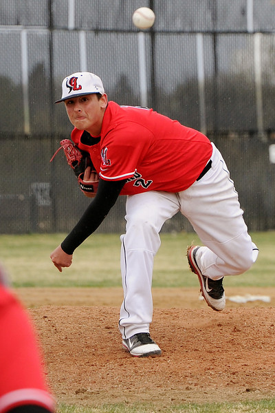 Loveland High School's Ryan Baca throws a pitch in the bottom of the first inning of a game against Thompson Valleyh on Tuesday, April 3, 2012 at Constantz Field.