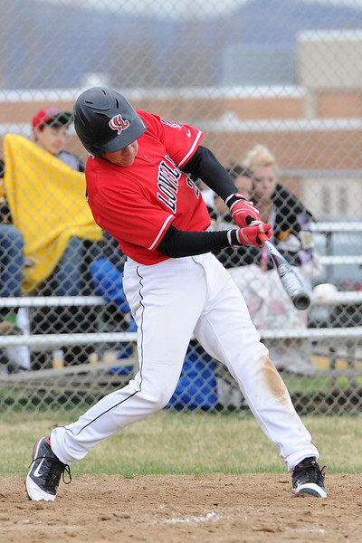 Loveland High School's Jay Larson hits a double in the top of the seventh inning of a game against Thompson Valley on Tuesday, April 3, 2012 at Constantz Field.