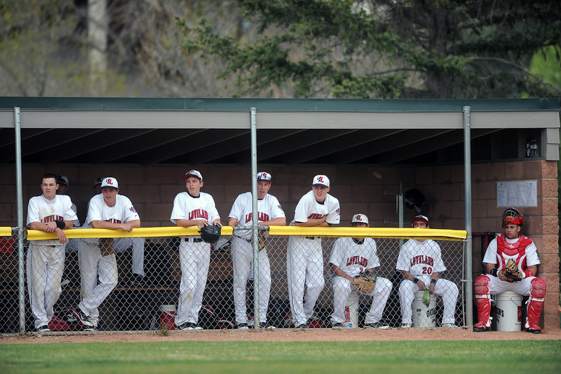 Loveland High School baseball players watch from the dugout during their game against Mountain Range on Thursday, April 19, 2012 at Swift Field.