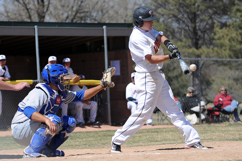 Loveland High School's Kylen Bakovich hits a single while Fruita-Monument catcher Evan McDermott looks on in the bottom of the fifth inning of their game Saturday, April 7, 2012 at Swift Field.