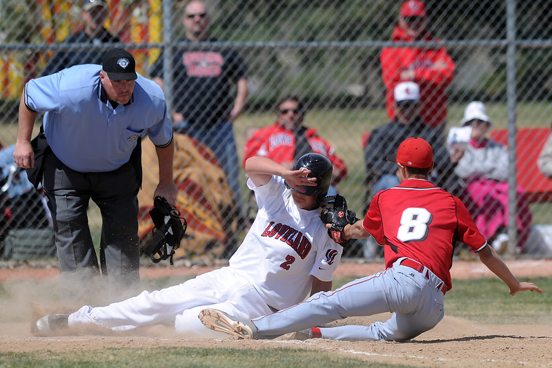 Loveland High School baserunner Ryan Baca is tagged out at home plate by Fairview pitcher Ryan Madden after Baca tried to score from third on a wild pitch in the bottom of the third inning of their game Saturday, April 14, 2012 at Swift Field.