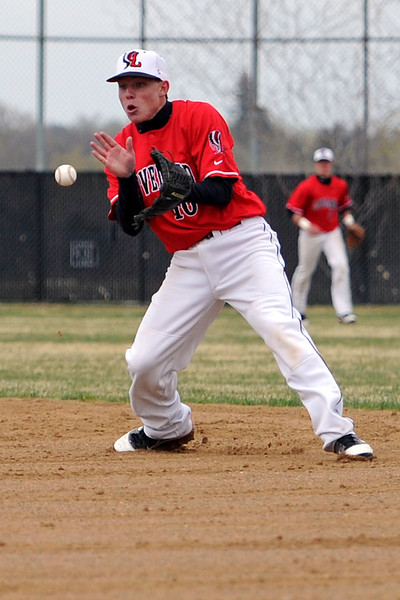Loveland High School second baseman Kylen Bakovich fields a ground ball in the bottom of the second inning of a game against Thompson Valley on Tuesday, April 3, 2012 at Constantz Field.