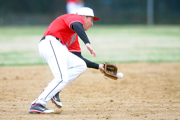 Loveland High School shortstop Jay Larson fields a ground ball in the bottom of the fourth inning of a game against Thompson Valley on Tuesday, April 3, 2012 at Constantz Field.