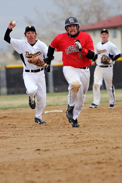 Thompson Valley High School shortstop Brad Soucek, left, pursues Loveland baserunner Matt Walkowicz on a rundown in the top of the third inning of their game on Tuesday, April 3, 2012 at Constantz Field.