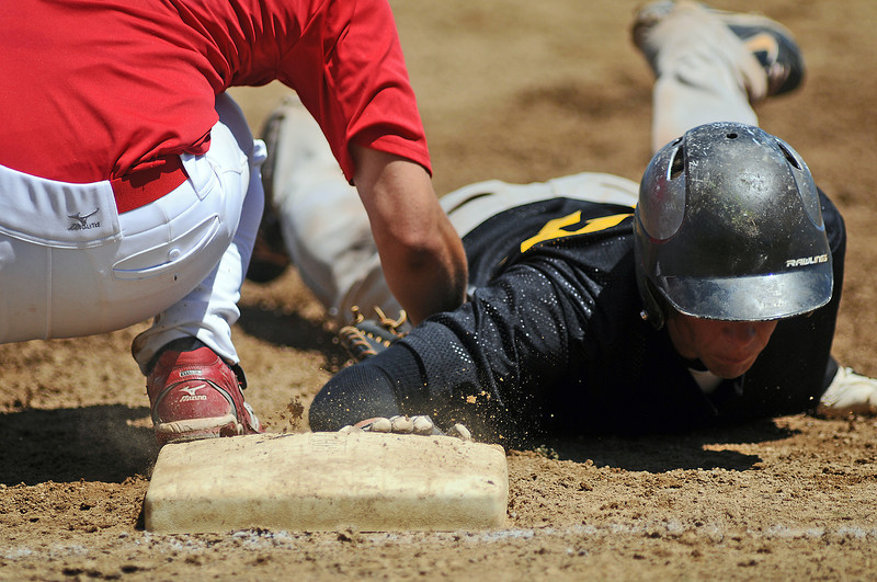 12 of SLS Financial slides safely back to first before the tag of 23 of Davidson-Gebhardt during the 4th inning on Tuesday afternoon at Constantz Field. Thompson Valley won the game 3-2.