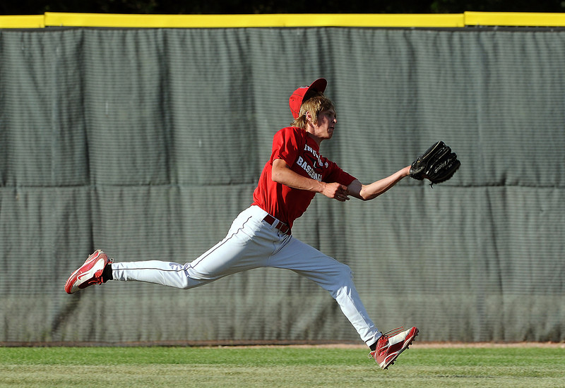 24 of Davidson-Gebhardt makes a catch on the run during the top of the 4th inning of Wednesday afternoon's game at Swift Field in Loveland. Longmont won the game 16-2.