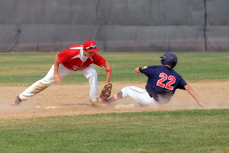 Second baseman JC Schneider of Loveland High School's summer team Davidson Chevrolet tags out Legion Post 7 baserunner Ross Melchor during the second game of their double header at Centennial Park on Wednesday, July 4, 2012.