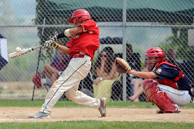 Dylan Underwood connects of Loveland High School's summer team Davidson Chevrolet connects for a triple in the second game of a double header against Legion Post 7 from Cheyenne at Centennial Park on Wednesday, July 4, 2012.