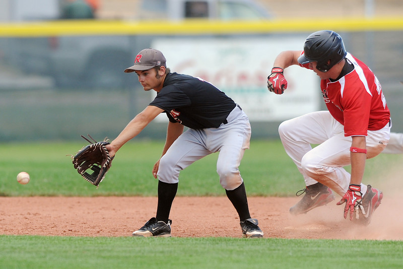 Davidson Chevrolet's Jay Larson slides in safely for a steal in front of Legions Post 70 second baseman Zach Courrejou in the bottom of the third inning of their game at Brock Field on Tuesday, July 17, 2012.